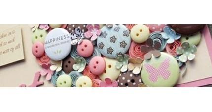 Botones borlas y charms